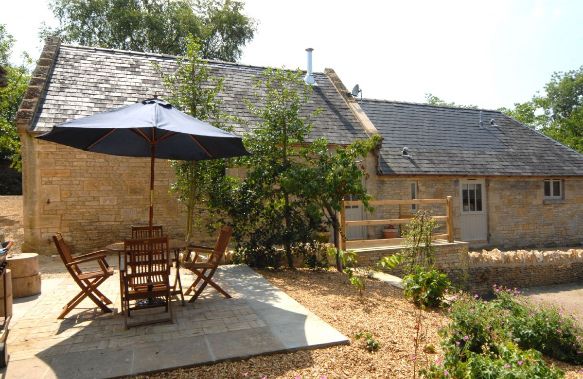 There is a patio area to the front of the barn with garden table and chairs and gas barbecue