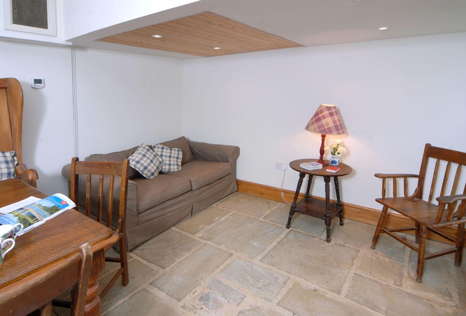 Watery Park Barn Ground floor:  Garden room with dining area