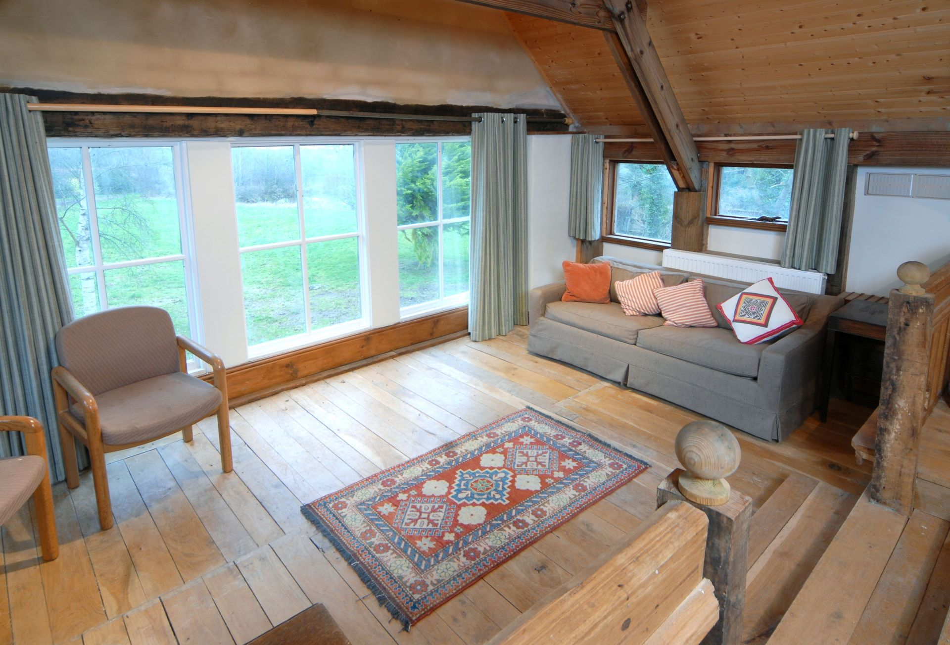 Watery Park Barn First floor: Between bedroom two and three there is a large seating area with views out onto the garden. There are 2 sofa beds in this area which can be curtained off and used to accommodate extra guests (max two) at an additional Ã'Â