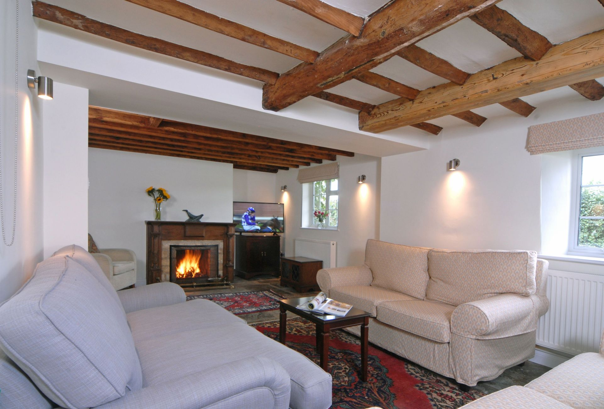 Hiron's Piece Ground floor: Sitting room with original flagstone flooring and an open fireplace