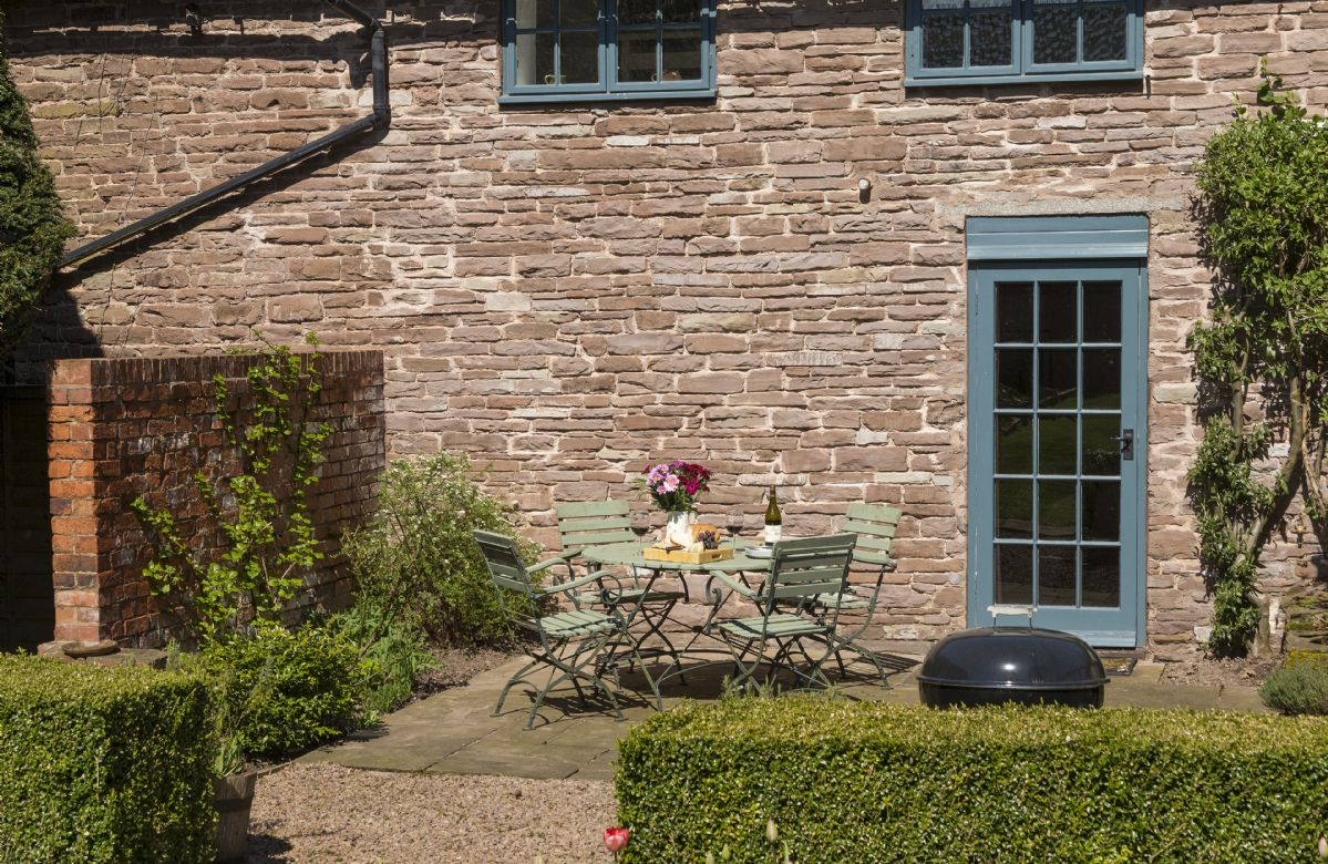 At the rear of Yewtree Cottage  is an attractive patio and garden