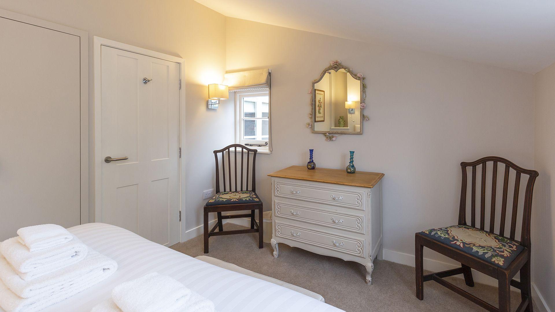 Master bedroom with views over garden, 14 Vineyard Street, Bolthole Retreats