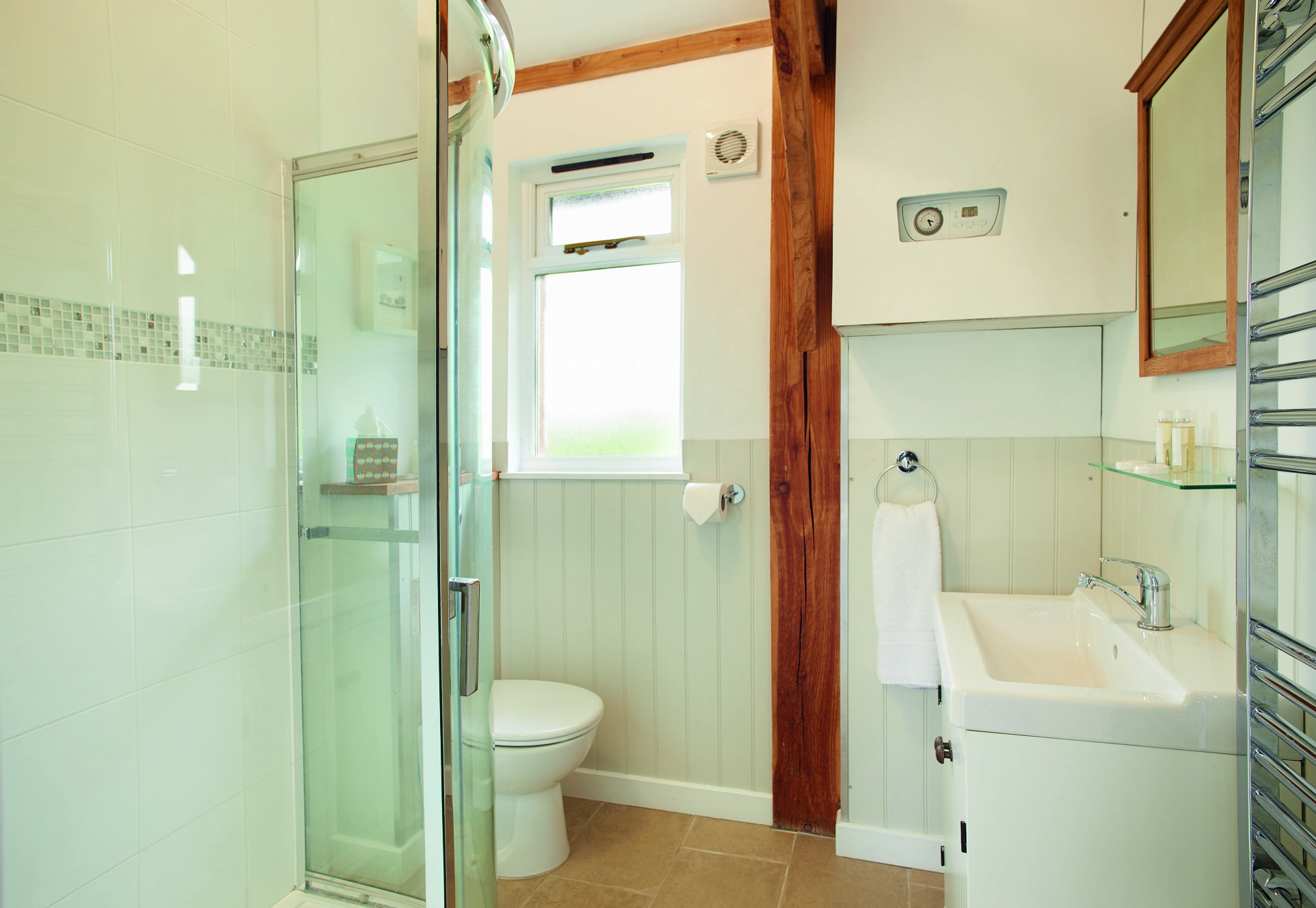 Ground floor:  Large shower room with over-head shower and handheld attachment