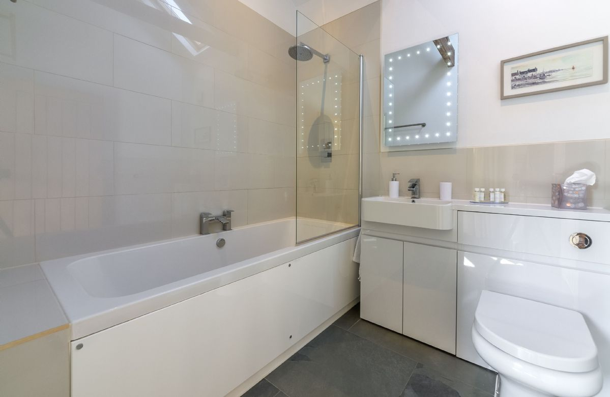 Ground floor: Bathroom with shower over