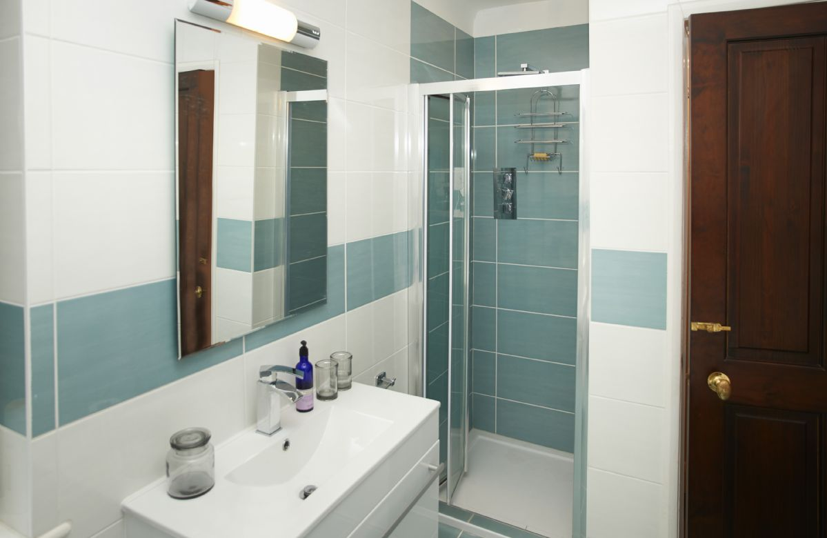 First floor: Family bathroom with shower and free-standing bath tub
