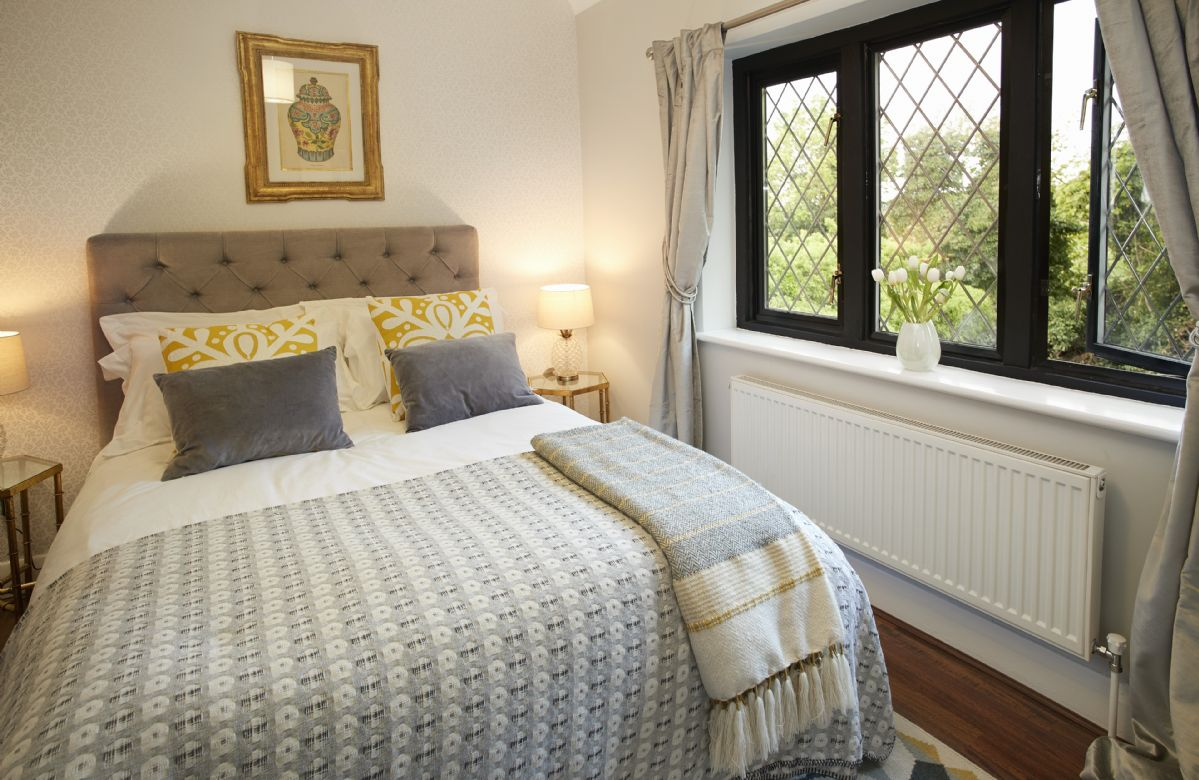 First floor: Third bedroom with double bed and golf course views