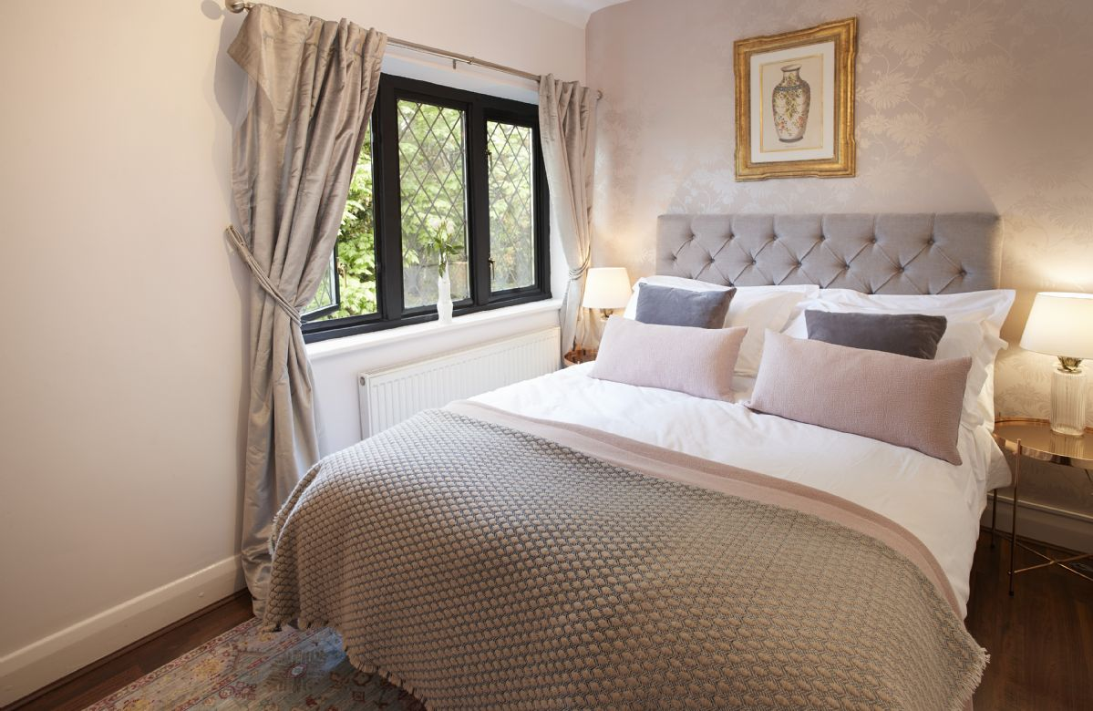 First floor: Fourth bedroom with double bed and golf course views