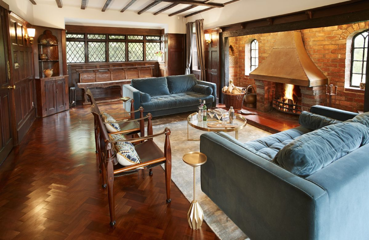 First floor: Oak paneled drawing room with inglenook fireplace