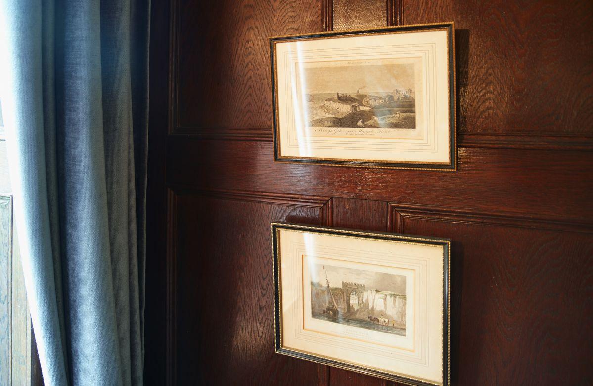 Traditional oak paneling on the TV/Snug room