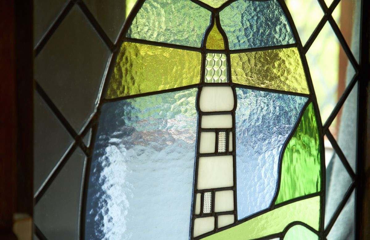 The stained glass in the front door is a nod to Northland Lighthouse just down the road