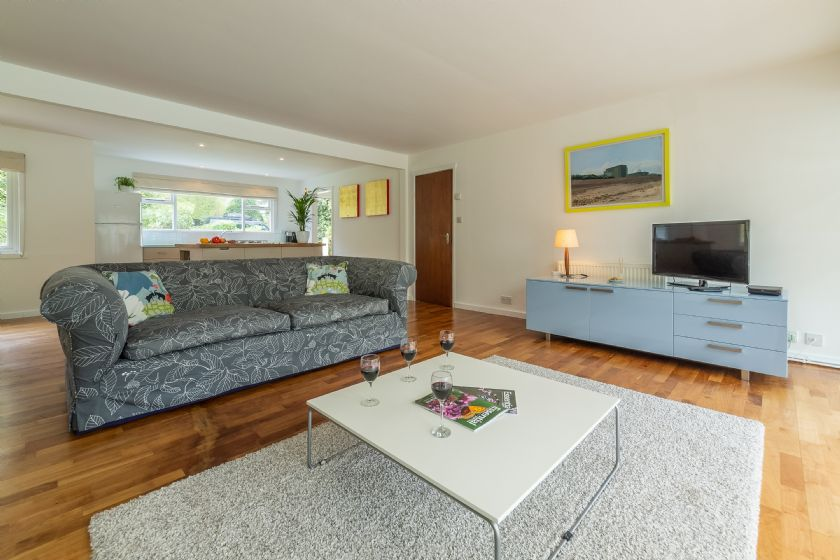 Ground floor: Open plan kitchen/dining/sitting area is well laid out with bright furniture
