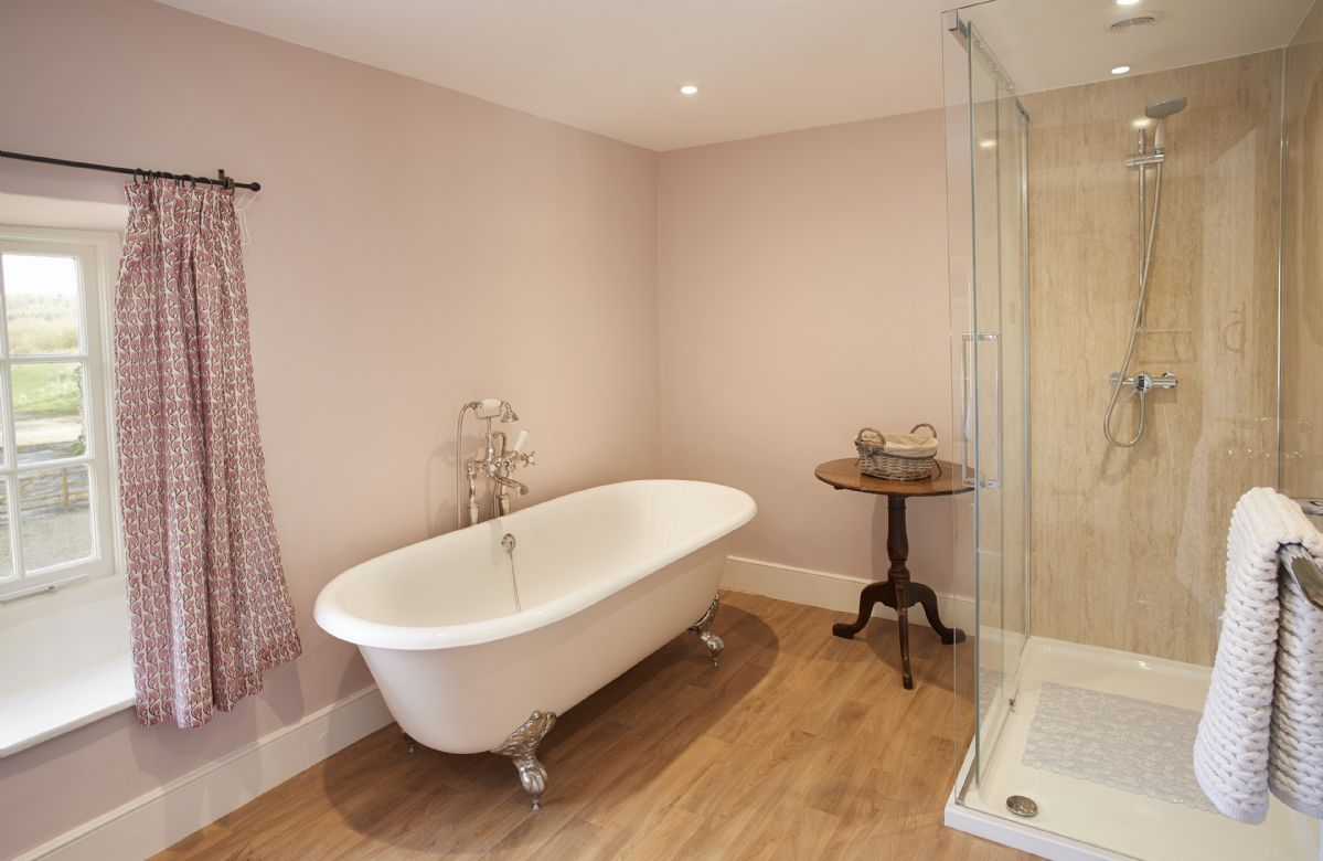 First Floor: Master en-suite with beautiful roll top bath and spacious shower