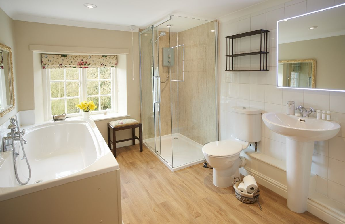 First Floor: Family bathroom with large separate shower and bath with hand held shower attachment
