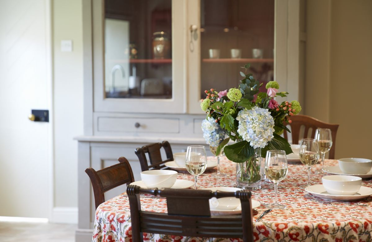 Ground Floor: Enjoy supper and a glass of wine in the farmhouse kitchen table seats six guests