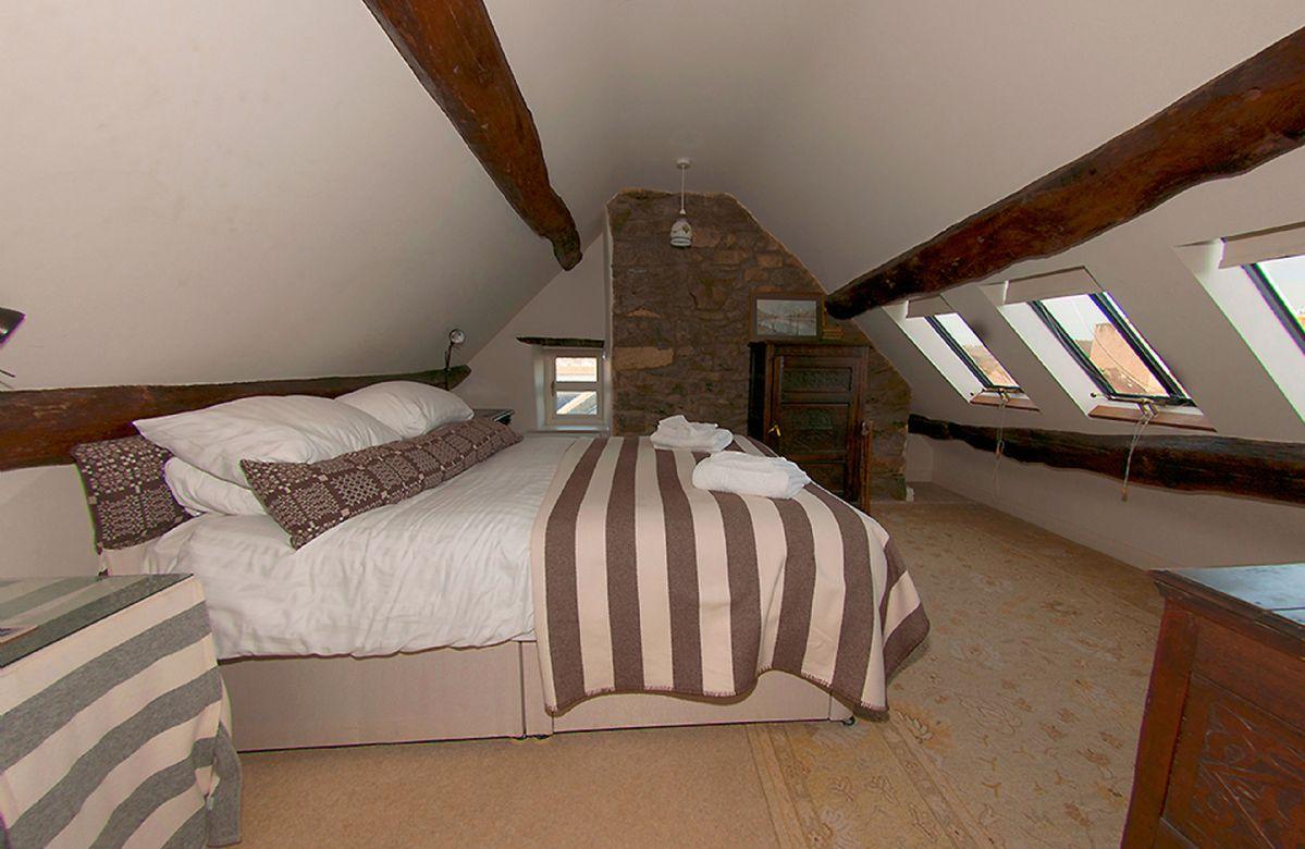 Second floor:  Mezzanine double bedroom suite with en-suite shower room and views of Conwy Castle