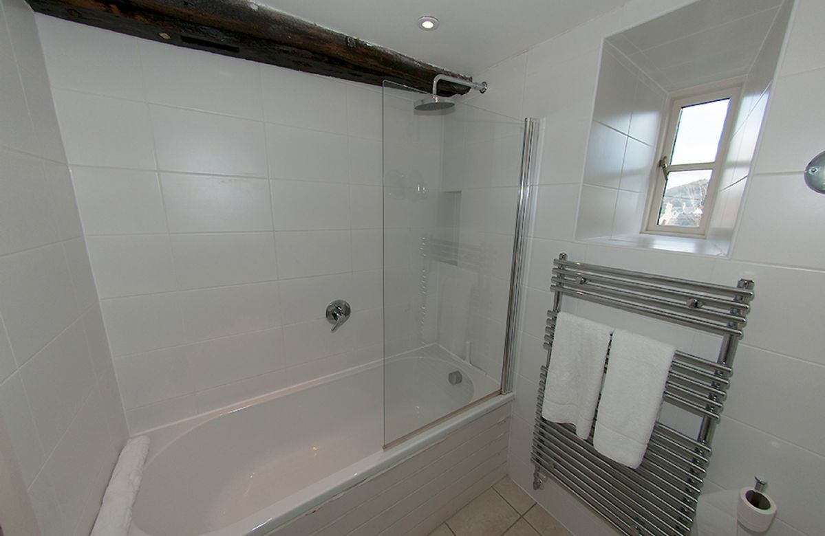 First floor: Bathroom with shower over the bath.