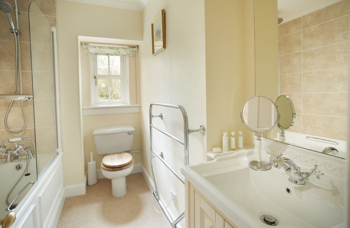 Ground floor: Family bathroom with bath and mixer shower