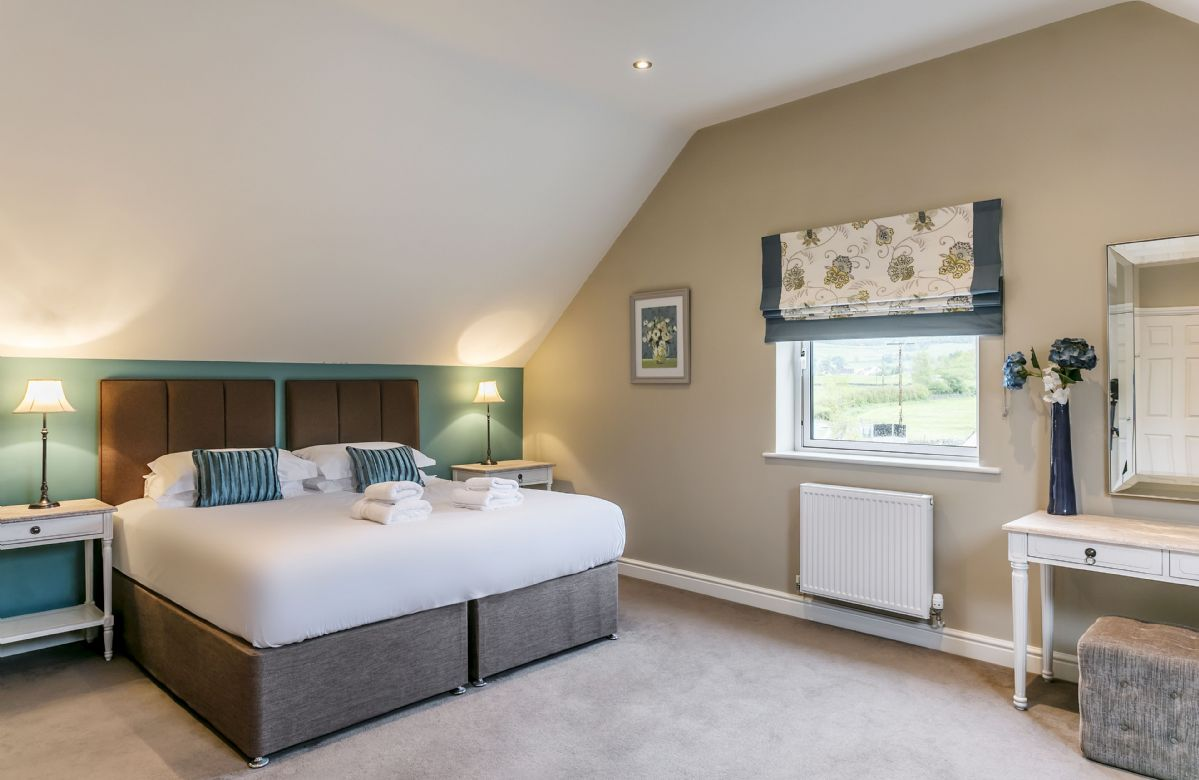 Second floor: Bedroom with 6' super king bed that can be configured as twin beds on request