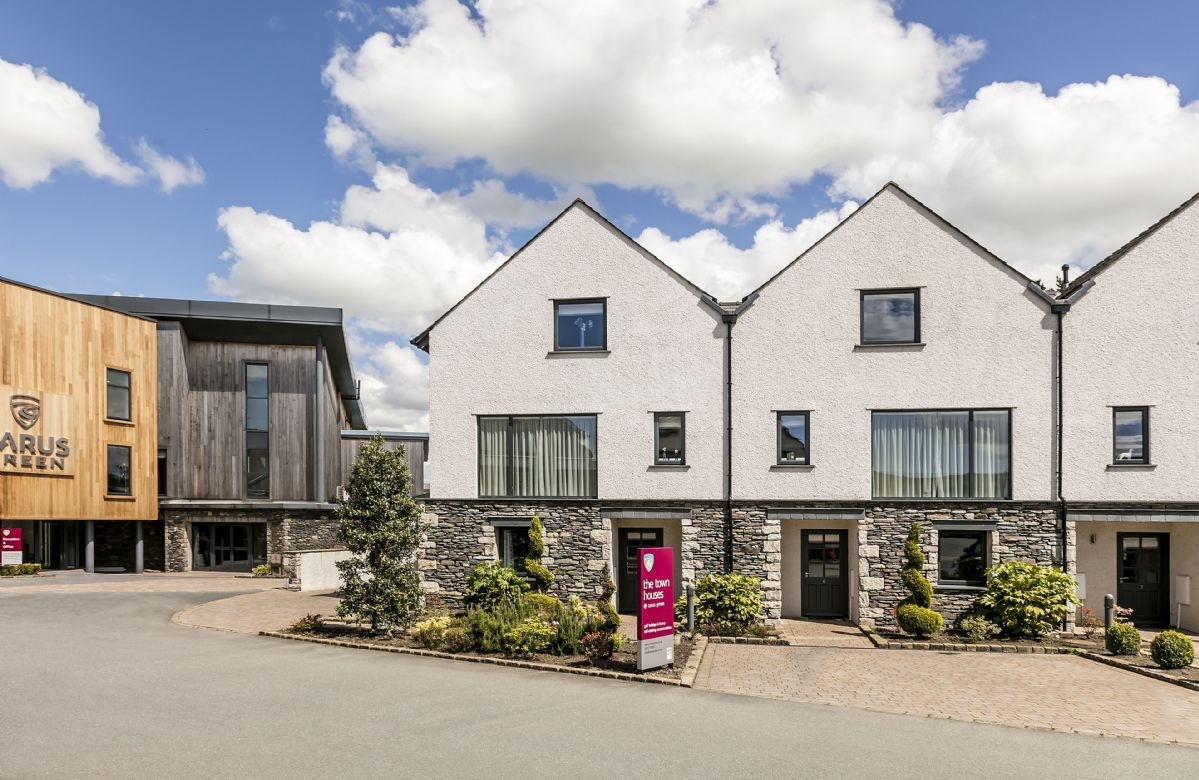 The clubhouse at Carus Green Golf Club is adjacent to the Townhouses