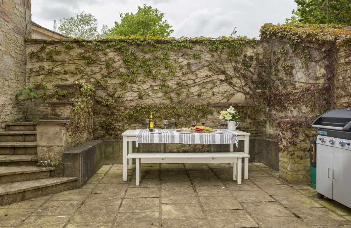Lower ground private outside eating area with gas barbecue