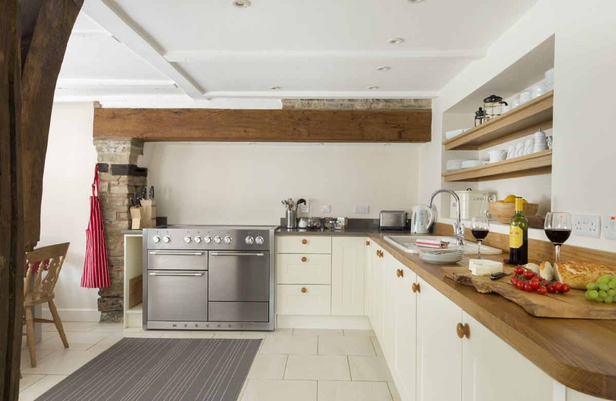 Ground floor:  Plenty of space to cook with three oven electric range cooker and fully equipped kitchen