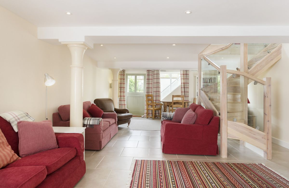 Lower ground: Spacious seating area with access to the front garden