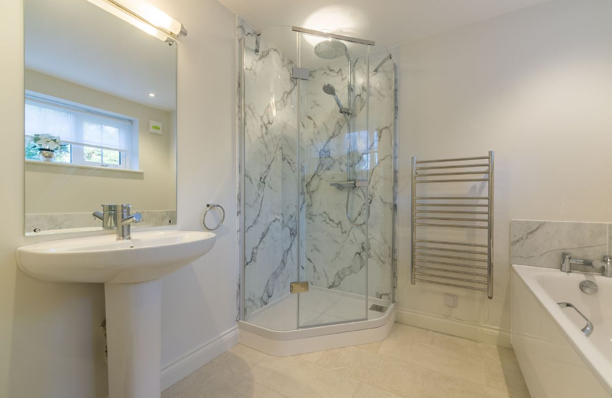 Ground floor: En-suite bathroom with bath and separate walk in shower