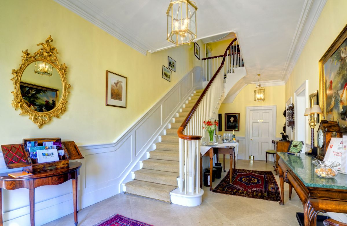 Ground Floor: Grand entrance hall and staircase leading to the first floor