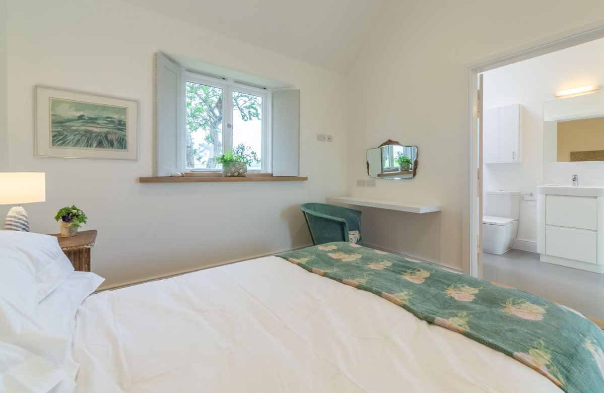 A bathroom with separate shower is accessible from the master bedroom and from the main corridor