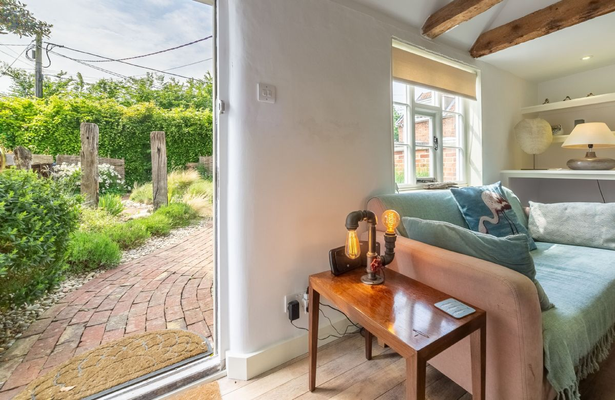 The sitting room looks on to the attractive landscaped courtyard garden