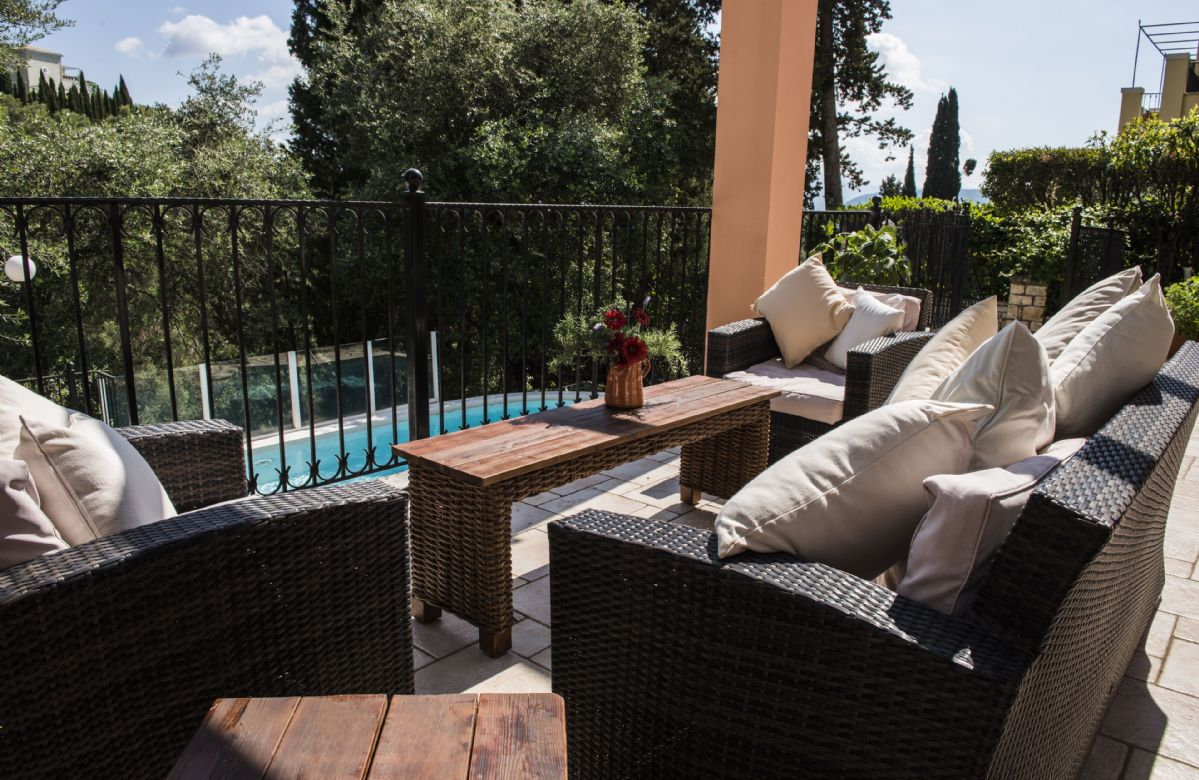 Pergola with comfortable outdoor furniture