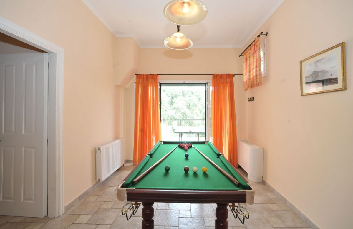 Ground floor: Games room with snooker table and board games