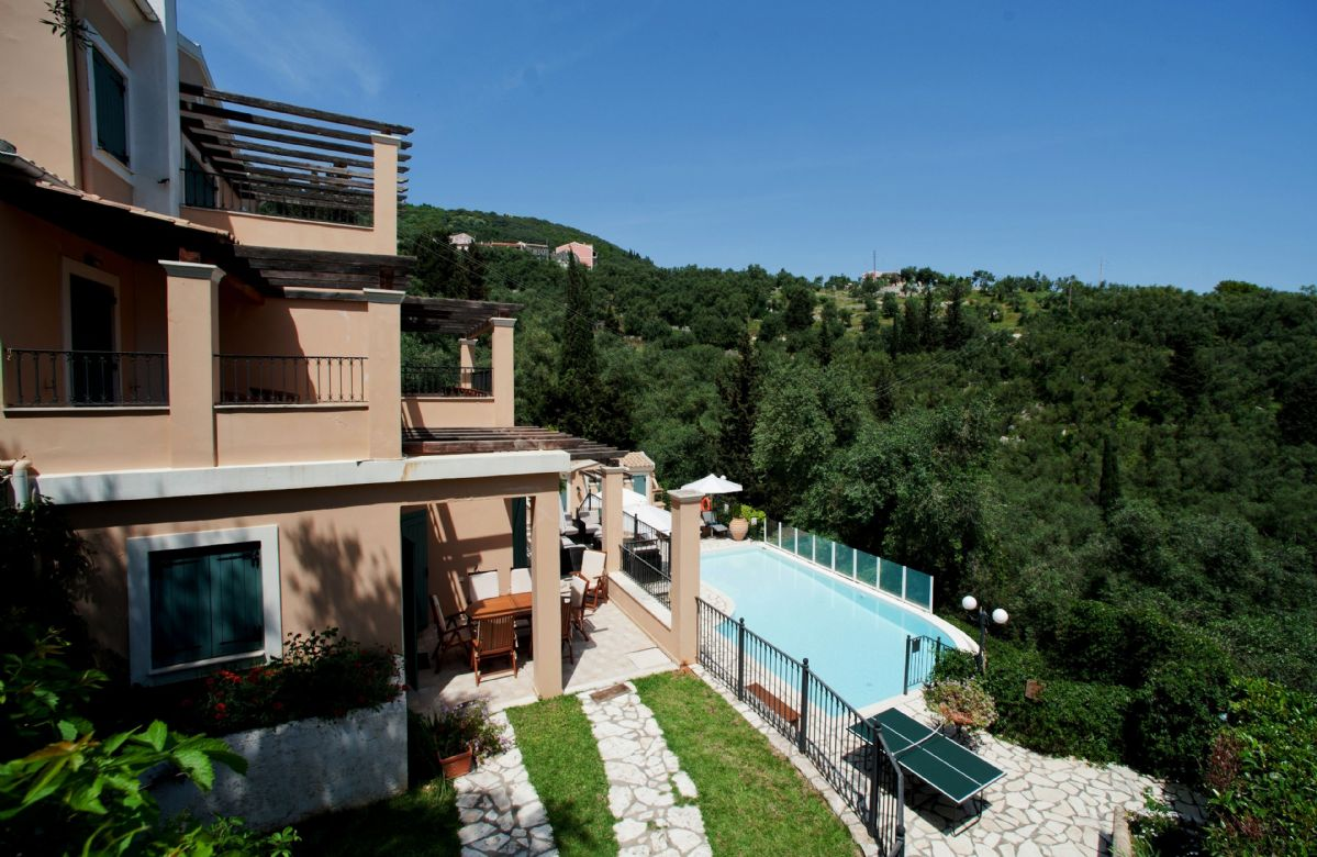 Villa Karydia is nestled on a hillside with olive groves on every side