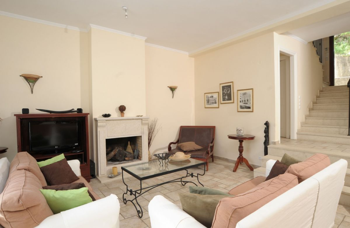 Ground floor: Sunken sitting room with open fireplace and French windows to terrace