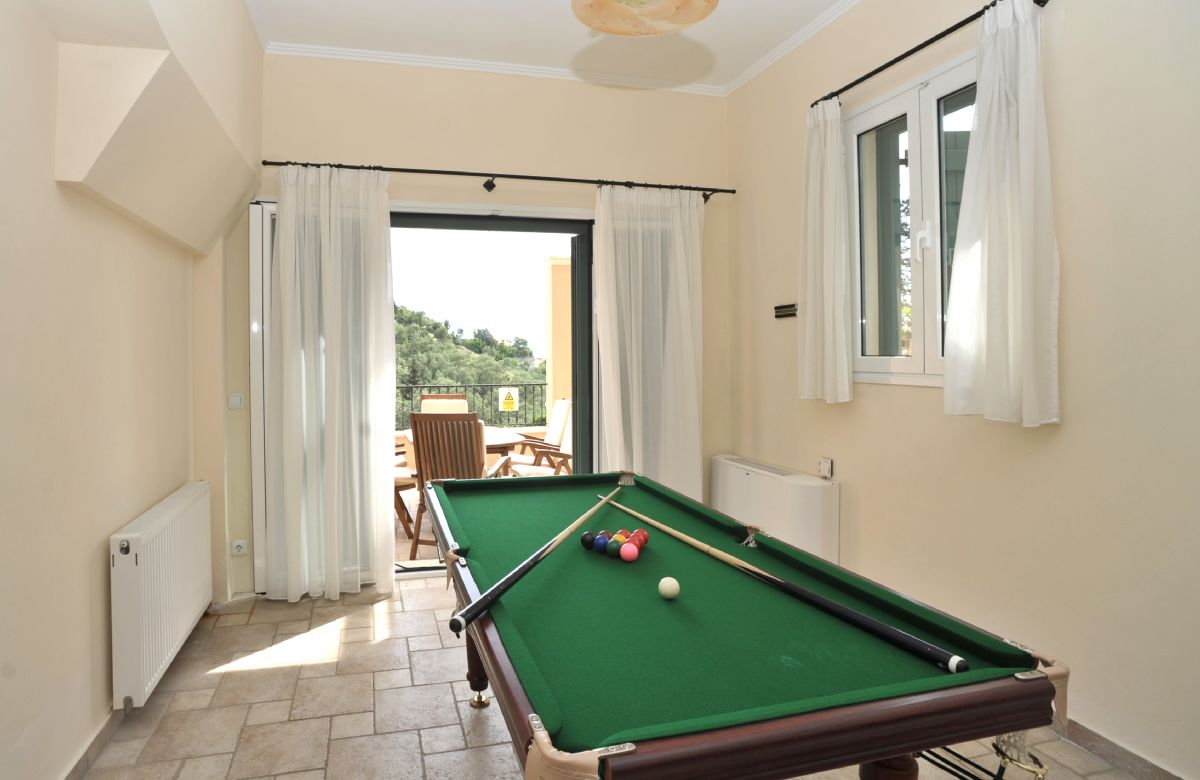 Ground floor: Games room with snooker table, board games and French windows to the veranda