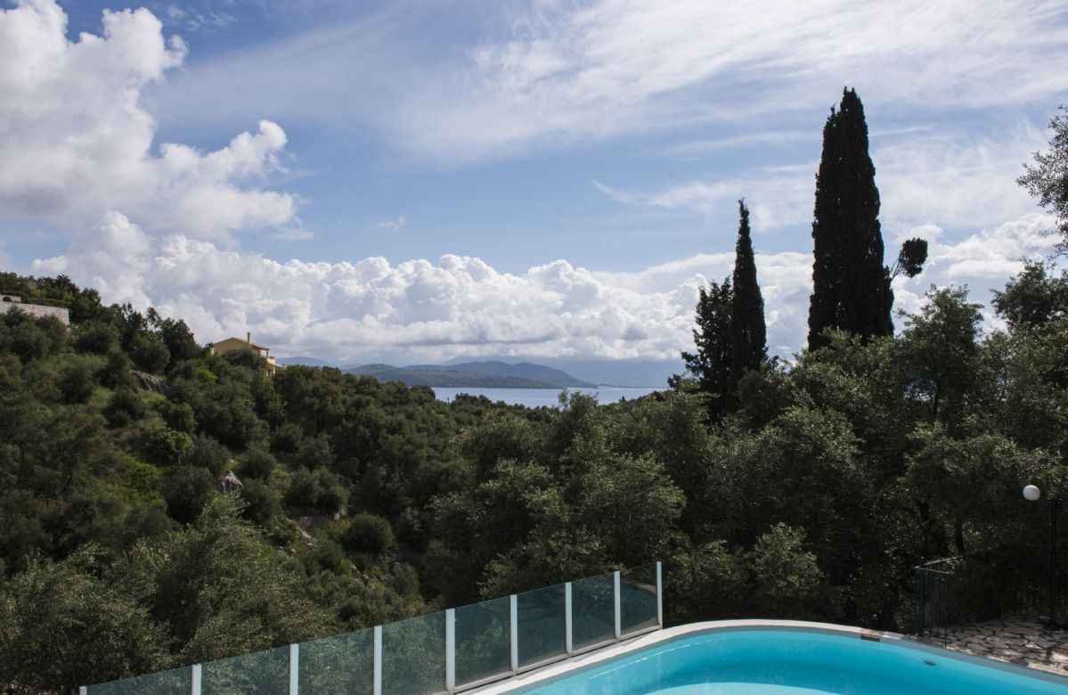 Elia is a split level property, with balconies to all first floor bedrooms and lovely sea views over the olive trees
