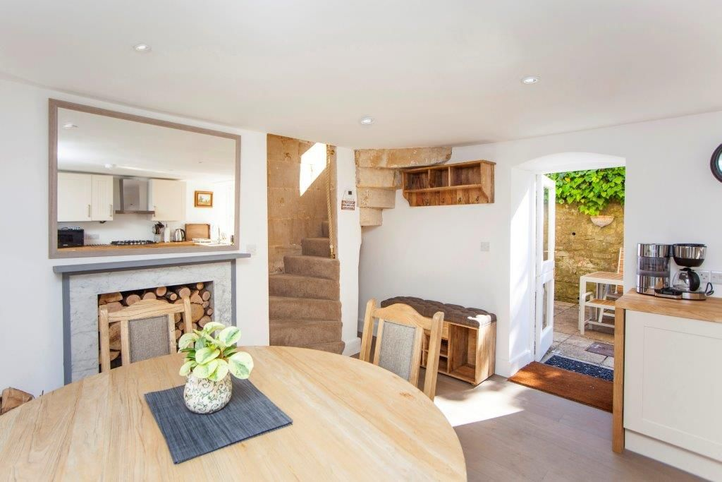 Open plan kitchen and dining leading to private courtyard