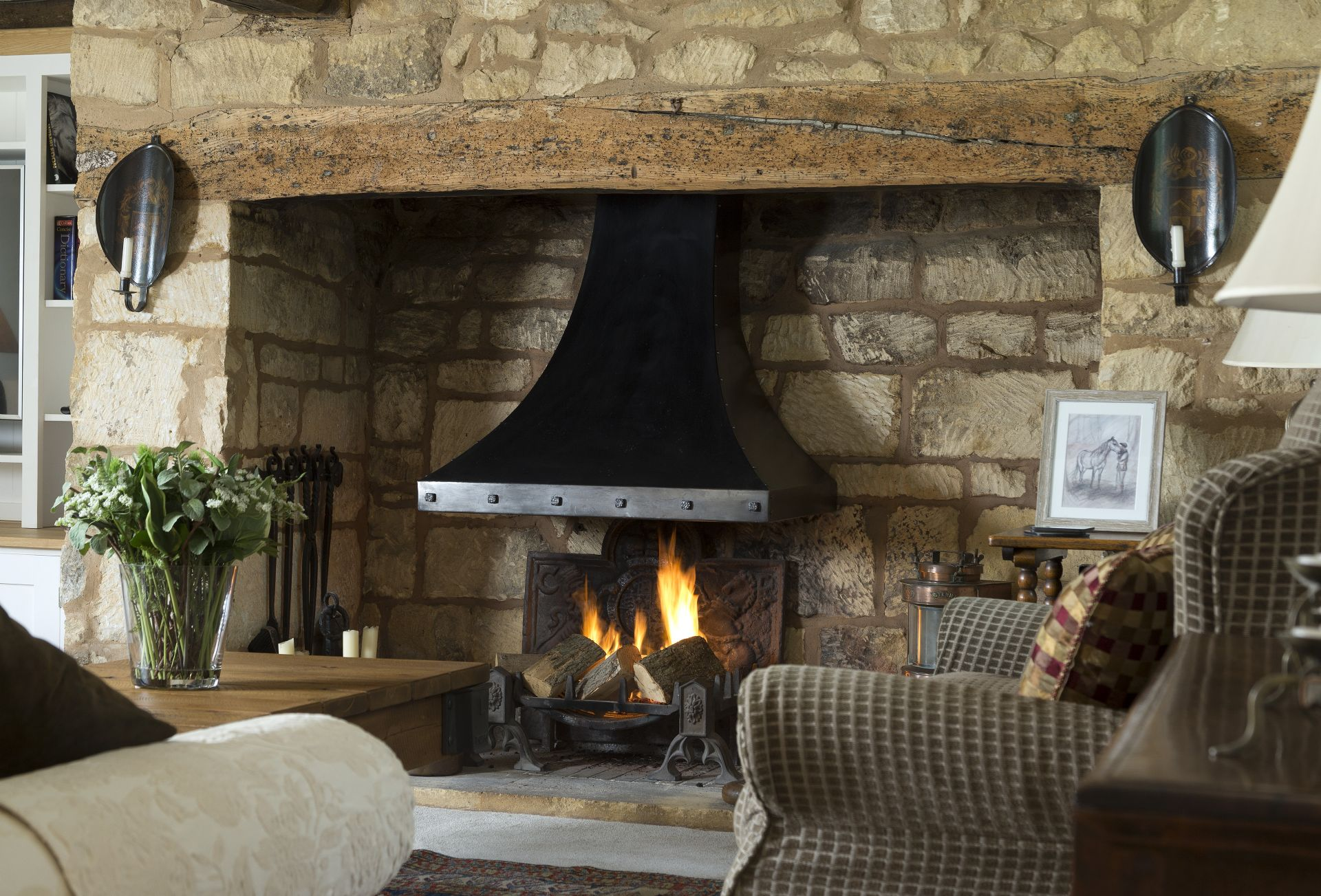 Ground floor: Large inglenook fireplace with open fire (no paper please)