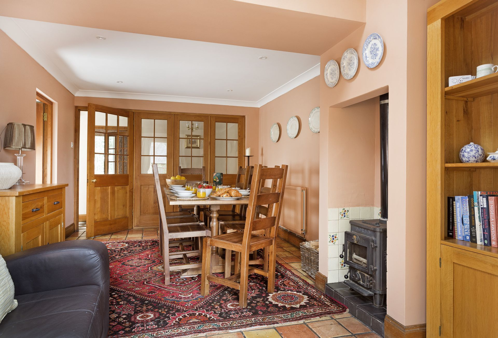 Ground floor:  Dining room with wood burning stove and sofa
