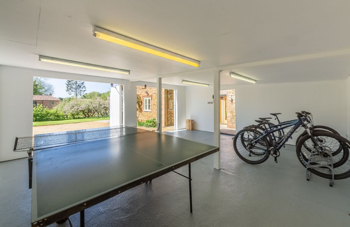 After exploring the grounds on bicycles return to a fun game of table tennis