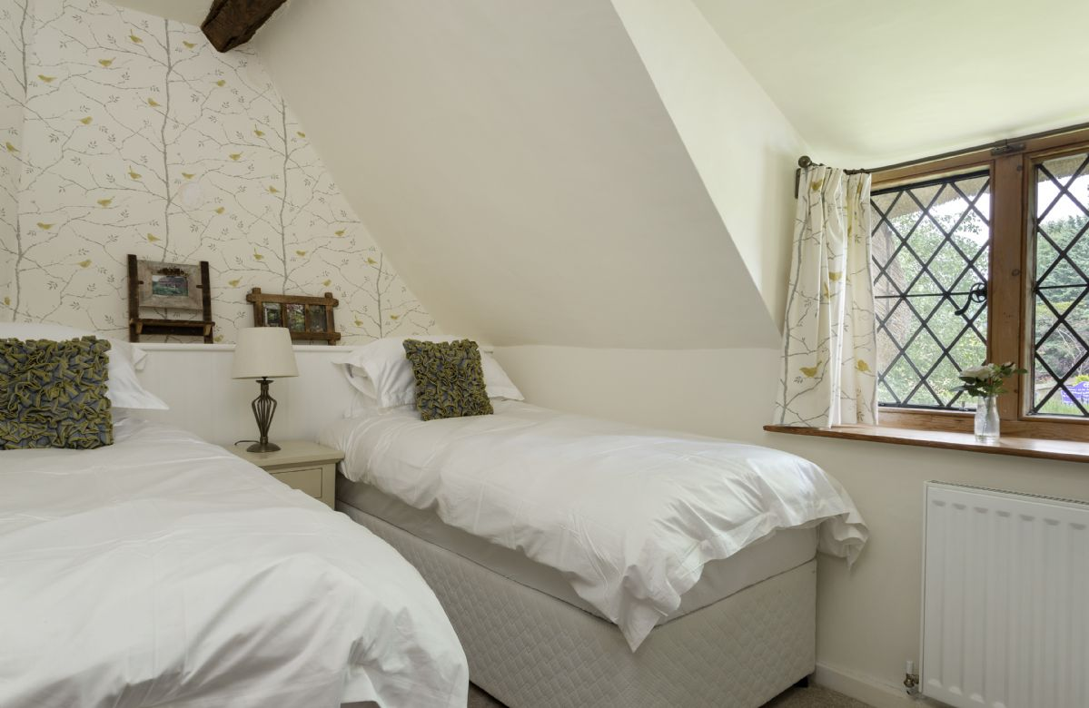 First floor: Twin bedroom with two 3' single beds