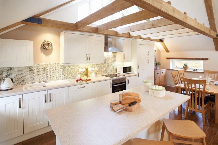 First floor: Open-plan kitchen, dining and sitting room
