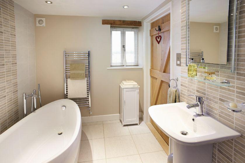 Ground floor:  En-suite bathroom with free standing bath