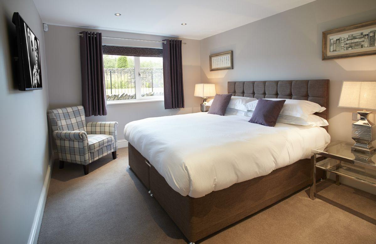 Ground floor: Bedroom Three with 6' super king bed and en-suite shower room