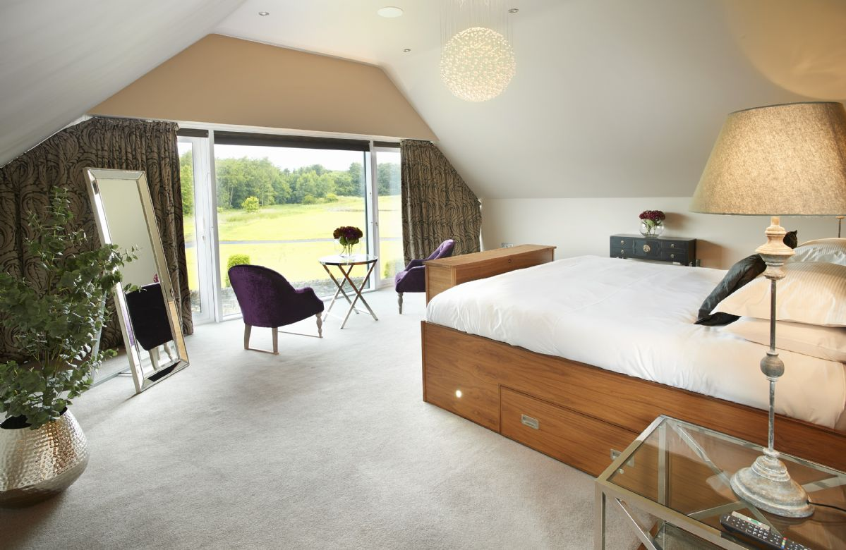Second floor: Master bedroom with emperor bed, dressing area and large windows overlooking the golf course