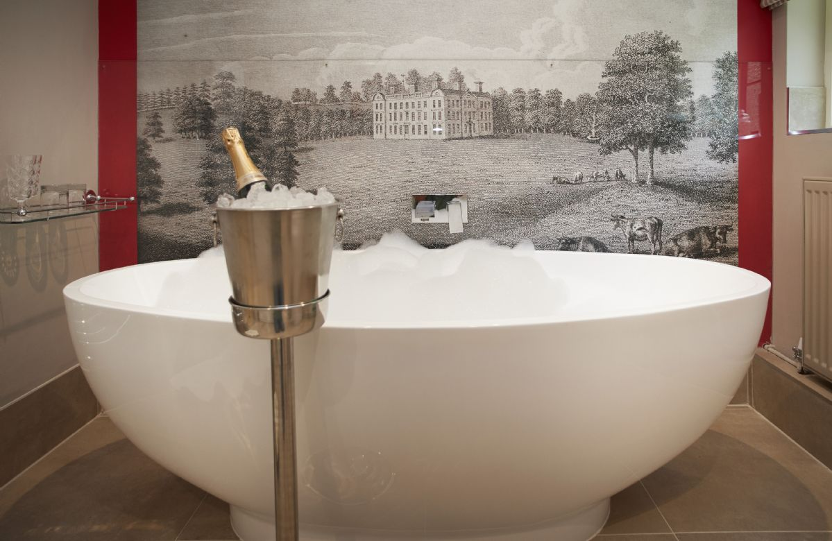 Ground floor: Bathroom with walk in rainforest shower, free standing bath and mural of  Weston Park