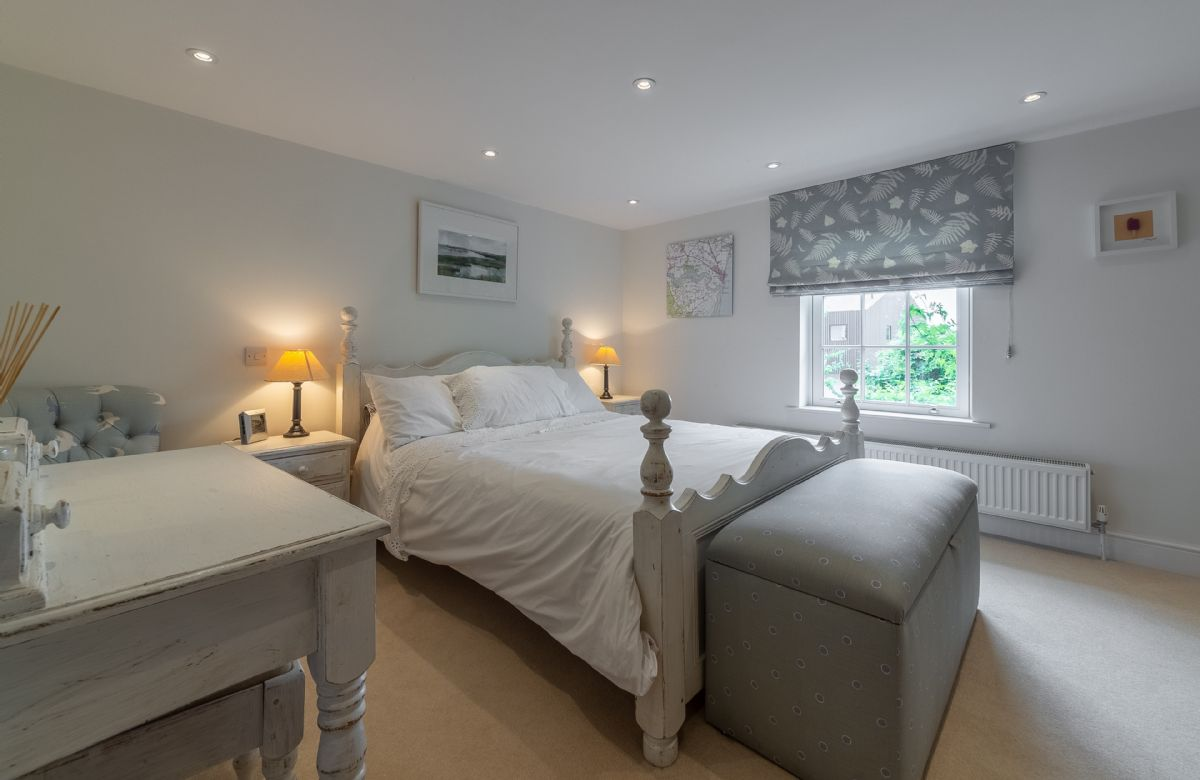 First floor: Spacious master bedroom with 5' king-size bed and views across the marshes to the river