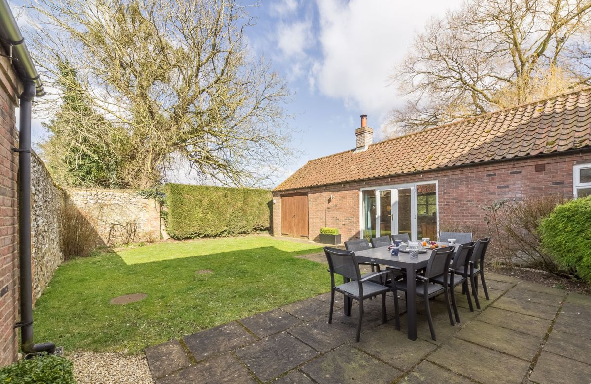 The rear garden is fully enclosed walled garden with outdoor dining area, lawn and access to the games room with a table tennis table