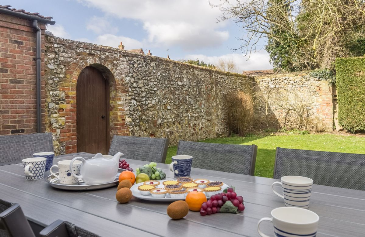 The rear garden is fully enclosed walled garden with outdoor dining area, lawn and access to the games room with table tennis table