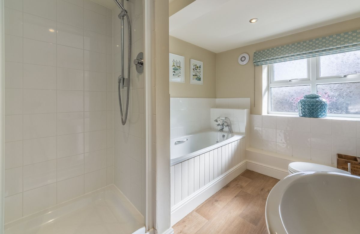Ground floor: Family bathroom with bath and separate shower
